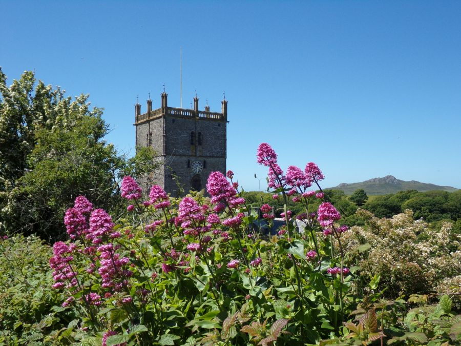 St Davids cathedral in summer with mountain in the background, photograph by AnneMarie Foley